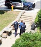Mens in Kitchener, Waterloo, Ontario wordt gearresteerd dat stock foto's