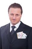 Mens in kostuum met geld Royalty-vrije Stock Afbeeldingen