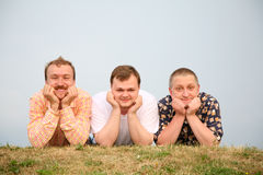 Mens laying on the grass Stock Photography