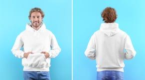 Mens in lege hoodiesweater op kleurenmeningen als achtergrond, voor en achter royalty-vrije stock afbeelding