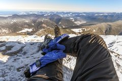 Mens legs in winter shoes against panorama over the Carpathian m. Ountains Stock Image