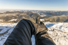 Mens legs in winter shoes against panorama over the Carpathian m Stock Image