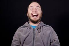 Mens luid lachen uit royalty-vrije stock afbeeldingen