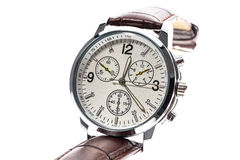 Mens luxury round swiss mechanical wrist watch with leather wris. Tband strap. Chronograph or tachometer isolated on white. High resolution photo Royalty Free Stock Image
