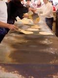 Mens Making talos, Tortilla than wraps txistorra. Royalty Free Stock Image