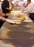 Mens Making talos, Tortilla than wraps txistorra. Stock Photo