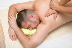Mens in massage stock foto's