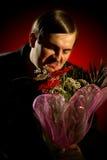 Mens met bloemen Royalty-vrije Stock Afbeeldingen