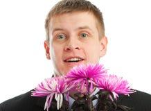 Mens met bloemen Royalty-vrije Stock Afbeelding