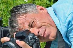 Mens met camera 10 royalty-vrije stock afbeelding