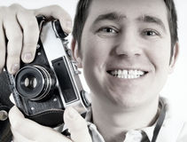 Mens met camera. Stock Foto