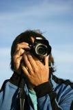 Mens met camera stock afbeeldingen