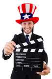 Mens met de hoed van de V.S. en geïsoleerde filmraad Stock Foto