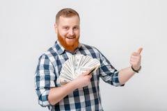 Mens met de partij van de baardholding van honderd-dollar rekeningen Stock Fotografie