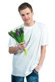 Mens met een boeket van tulpen Royalty-vrije Stock Fotografie