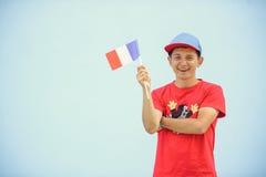 Mens met een Franse vlag Royalty-vrije Stock Fotografie