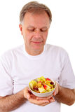 Mens met een fruit salat stock foto