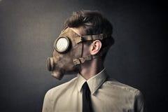 Mens met een gasmasker Stock Afbeelding