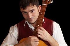 Mens met een gitaar Stock Fotografie