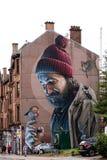 Mens met een Hoofdstraat Glasgow van Robin On His Finger Mural Moderne Dagmungo royalty-vrije stock fotografie