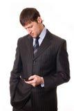 Mens met een mobiele in hand telefoon Royalty-vrije Stock Afbeeldingen