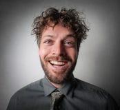 Mens met een vrolijk gezicht royalty-vrije stock fotografie