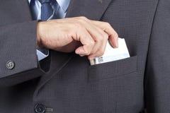 Mens met Geld in de Zak royalty-vrije stock fotografie