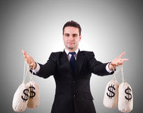 Mens met geldzakken op wit Royalty-vrije Stock Foto's
