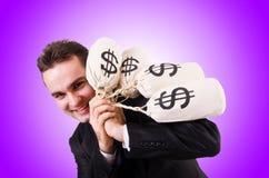 Mens met geldzakken op wit Stock Fotografie