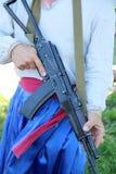 Mens met geweer ak-47 Stock Afbeeldingen