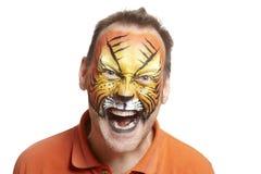 Mens met gezicht het schilderen tijger Stock Foto