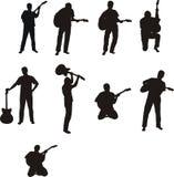 Mens met gitaar - silhouetten Royalty-vrije Stock Foto