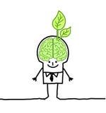 Mens met groen hersenen & blad Stock Foto's