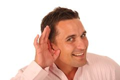 Mens met hand aan oor royalty-vrije stock foto