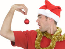 Mens met het Ornament van Kerstmis stock foto's
