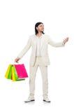 Mens met het winkelen zakken die op wit wordt geïsoleerd Royalty-vrije Stock Afbeelding