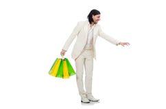 Mens met het winkelen zakken die op wit wordt geïsoleerd Royalty-vrije Stock Afbeeldingen