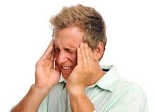 Mens met hoofdpijn in studio royalty-vrije stock foto