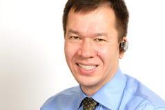 Mens met Hoofdtelefoon Bluetooth Royalty-vrije Stock Afbeelding