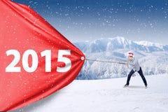 Mens met Kerstmishoed en nummer 2015 Royalty-vrije Stock Foto's