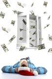Mens met Kerstmishoed het letten op vliegende dollars Stock Foto's
