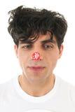 Mens met kortingssticker op neus Royalty-vrije Stock Afbeelding