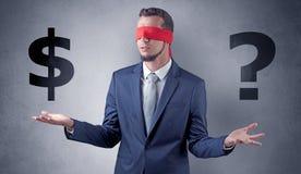 Mens met lint op zijn de dollartekens van de oogholding Royalty-vrije Stock Foto