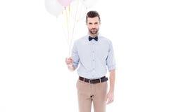 Mens met luchtballons Stock Afbeelding