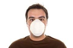 Mens met masker - verontreinigingsconcept stock afbeelding