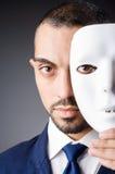 Mens met maskers Royalty-vrije Stock Afbeeldingen