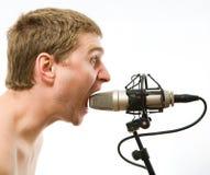Mens met microfoon Royalty-vrije Stock Foto's