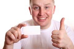 Mens met omhoog kaart en duim Royalty-vrije Stock Afbeelding