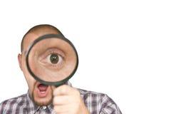 Mens met overdreven oog Stock Foto's