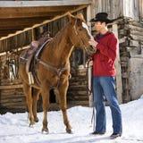 Mens met paard. stock afbeelding
